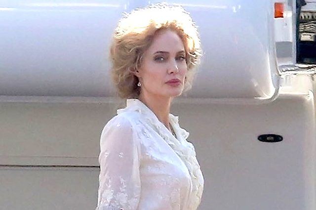 ** RIGHTS: NO WEB ** Hollywood, CA  - *PREMIUM-EXCLUSIVE* **STRICT WEB EMBARGO UNTIL 8:00 AM PT on September 26, 2018**Actress Angelina Jolie is seen in full costume and wig as Rose on the set of her latest film 'Come Away' at a studio lot in Hollywood. Angelina's co-stars on the project, David Oyelowo and Jordan A. Nash, who plays Peter Pan, were also seen arriving on set. The fantasy film, directed by  Brenda Chapma, is a  prequel to the stories of Peter Pan and Alice in Wonderland. *Shot on September 24, 2018*  Pictured: Angelina Jolie  BACKGRID USA 25 SEPTEMBER 2018   BYLINE MUST READ: W Blanco / BACKGRID  USA: +1 310 798 9111 / usasales@backgrid.com  UK: +44 208 344 2007 / uksales@backgrid.com  *UK Clients - Pictures Containing Children Please Pixelate Face Prior To Publication*