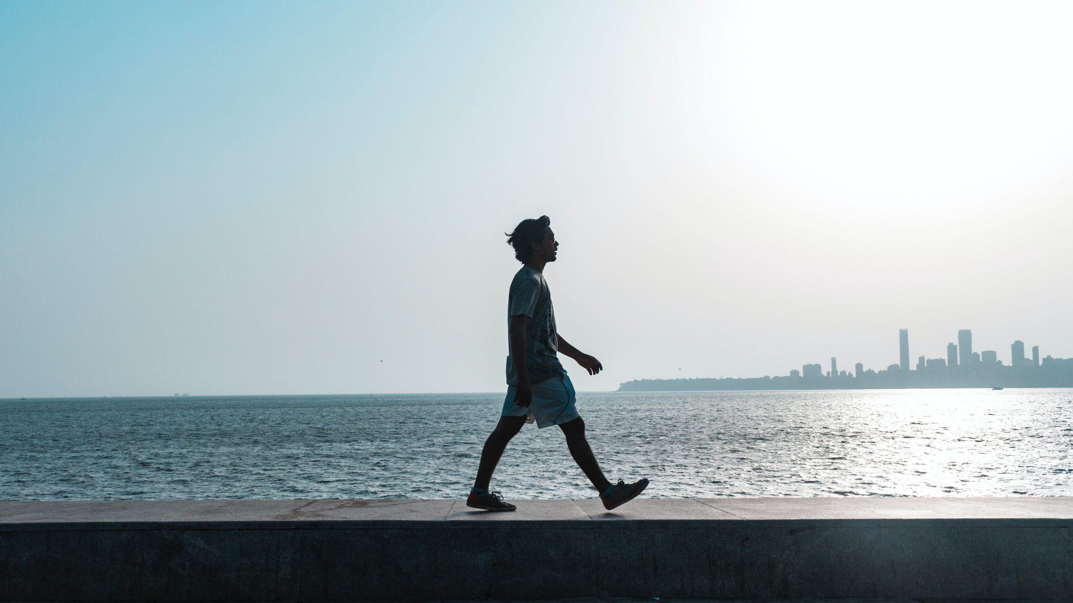 man-walking-near-body-of-water-1466852