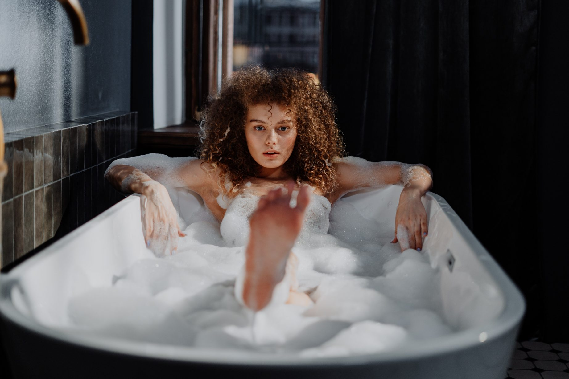 woman-in-bathtub-with-water-4155496