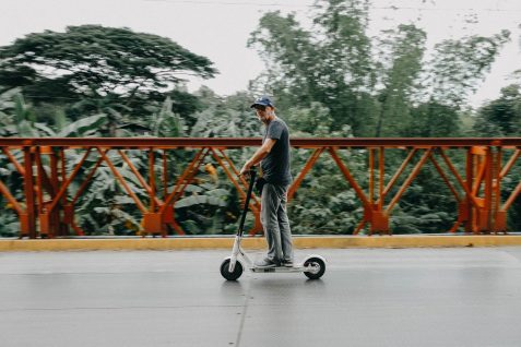 man-riding-on-bird-electric-scooter-1379374