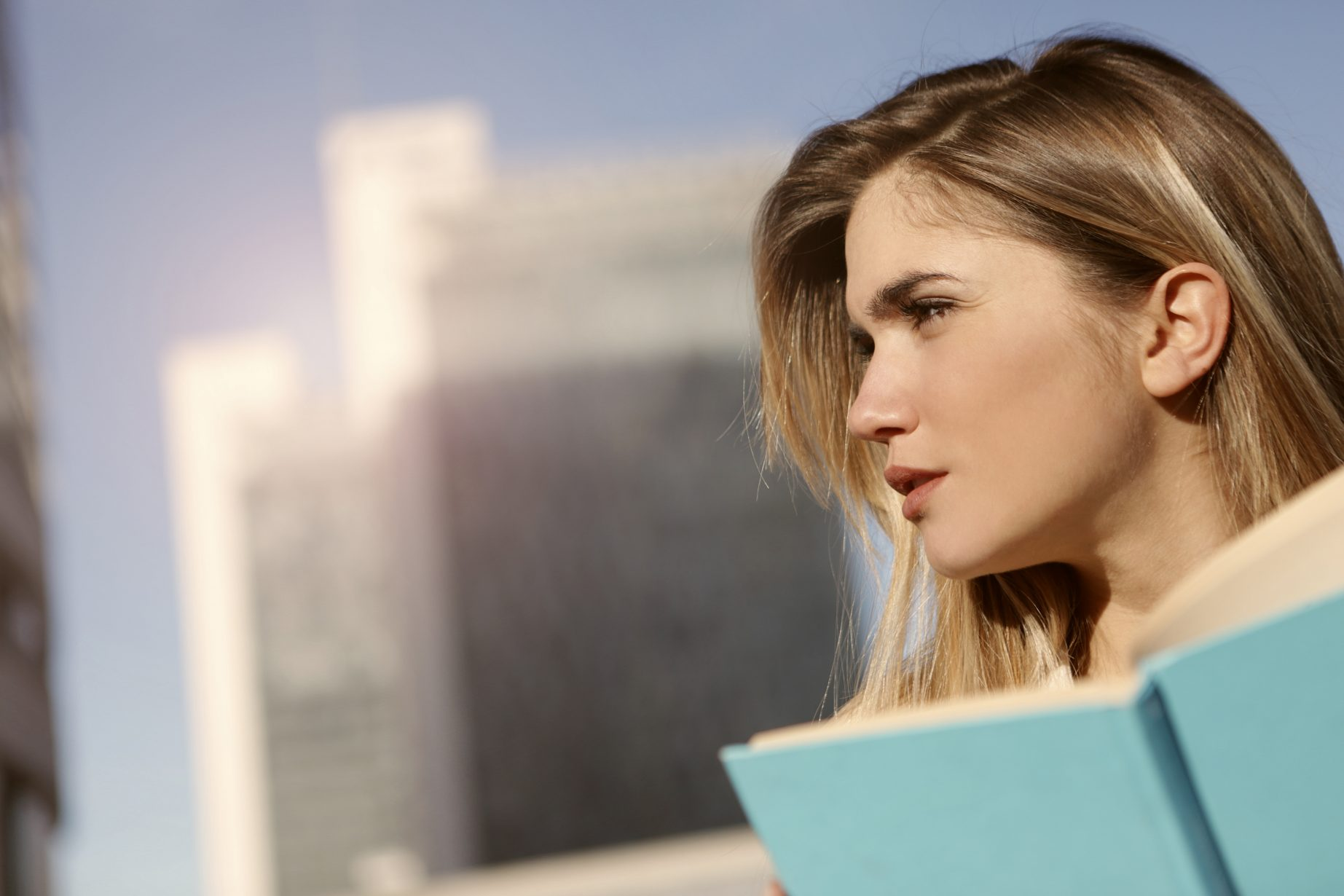 side-view-photo-of-a-woman-holding-blue-book-3781537