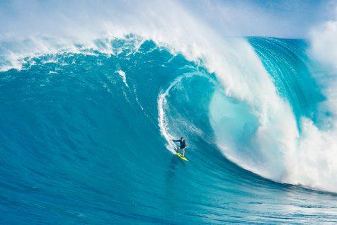 MAUI, HI - MARCH 13: Professional surfer Carlos Burle rides a gi